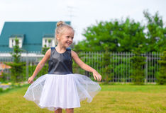 Adorable little girl happy outdoor at summer time Royalty Free Stock Images