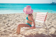 Adorable little girl in hat at beach during royalty free stock photo