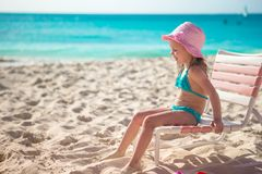 Adorable little girl in hat at beach during stock photos