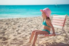 Adorable little girl in hat at beach during Royalty Free Stock Photography
