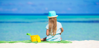 Adorable little girl in hat at beach during summer Royalty Free Stock Photos