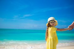 Adorable little girl in hat at beach during summer vacation Royalty Free Stock Photography