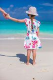 Adorable little girl in hat at beach during summer vacation Stock Images