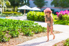 Adorable little girl at hat and swmsuit in exotic Royalty Free Stock Photo