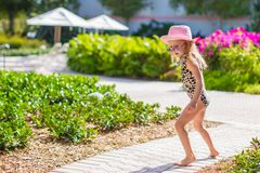 Adorable little girl at hat and swmsuit in exotic Royalty Free Stock Photography