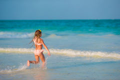 Adorable little girl have fun at beach Royalty Free Stock Image