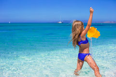 Adorable little girl have fun with beach toy Stock Images