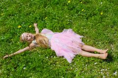 Adorable little girl have fun in blossoming apple Stock Photography