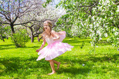 Adorable little girl have fun in blossoming apple Stock Photo