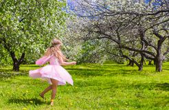 Adorable little girl have fun in blossoming apple Royalty Free Stock Images