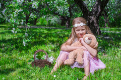 Adorable little girl have fun in blossoming apple Royalty Free Stock Photos