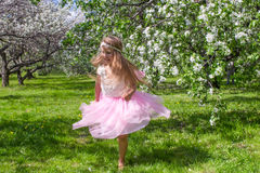 Adorable little girl have fun in blossoming apple Royalty Free Stock Photography