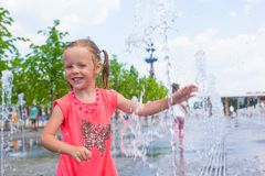 Adorable little girl have fun at hot sunny summer Stock Photos