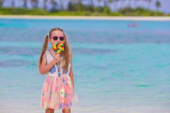 Adorable little girl have fun with lollipop on the Stock Photo