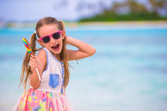 Adorable little girl have fun with lollipop on the Royalty Free Stock Photography