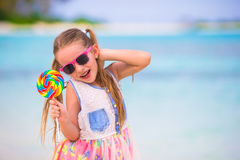 Adorable little girl have fun with lollipop on the Stock Images