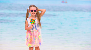 Adorable little girl have fun with lollipop on the Royalty Free Stock Images