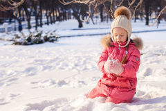 Adorable little girl have fun outdoor on cold Royalty Free Stock Images