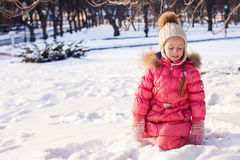 Adorable little girl have fun outdoor on cold Stock Photos