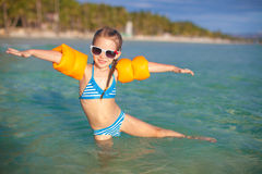 Adorable little girl have fun in the sea on Royalty Free Stock Photography