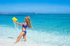 Adorable little girl have fun in shallow water at Royalty Free Stock Images
