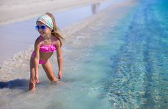 Adorable little girl have fun in shallow water at Royalty Free Stock Photography