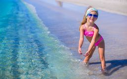 Adorable little girl have fun in shallow water at Stock Photography