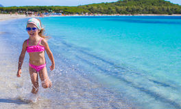 Adorable little girl have fun in shallow water at Stock Image