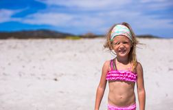 Adorable little girl have fun in shallow water at Royalty Free Stock Photos