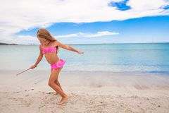 Adorable little girl have fun in shallow water at Stock Images