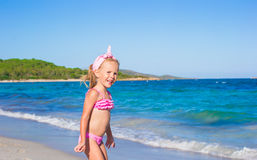 Adorable little girl have fun in shallow water at Stock Photo