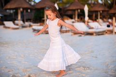 Adorable little girl have fun at sunset beach Royalty Free Stock Photography