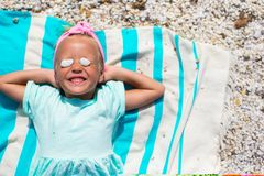 Adorable little girl have fun on towel at white Stock Image