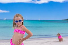 Adorable little girl have fun during tropical Stock Images