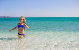 Adorable little girl have fun at tropical beach in Stock Photography