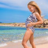 Adorable little girl have fun at tropical beach Stock Image