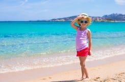 Adorable little girl have fun at tropical beach Stock Photos