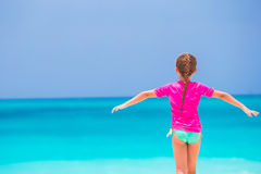 Adorable little girl have fun at tropical beach during vacation Stock Images