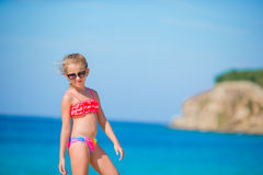 Adorable little girl have fun at tropical beach during vacation. Adorable little girl at tropical beach on vacation Royalty Free Stock Photography