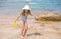 Adorable little girl have fun at tropical beach Stock Images