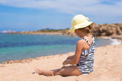 Adorable little girl have fun at tropical beach Royalty Free Stock Image