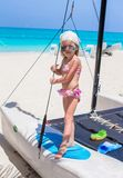 Adorable little girl have fun on a yacht during Stock Image