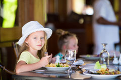 Adorable little girl having breakfast at outdoor Royalty Free Stock Image