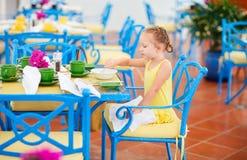 Little girl having breakfast Royalty Free Stock Image
