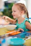 Little girl having breakfast Stock Photos