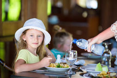 Adorable little girl having dinner at outdoor Royalty Free Stock Photos