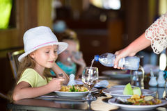 Adorable little girl having dinner at outdoor Royalty Free Stock Images