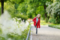 Adorable little girl having fun on autumn day Stock Photos