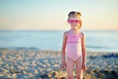 Adorable little girl having fun on a beach Royalty Free Stock Photos