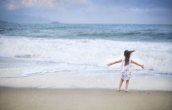 Adorable little girl having fun at beach during summer vacation Royalty Free Stock Images